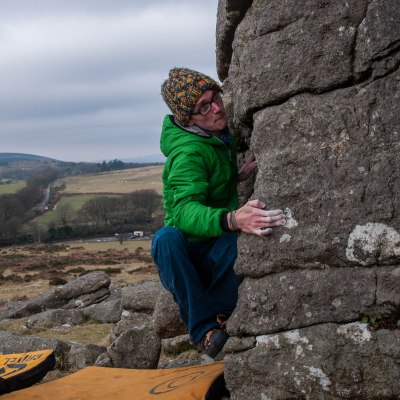 Sam warming up on some of Hound Tor's stunning granite boulders.
