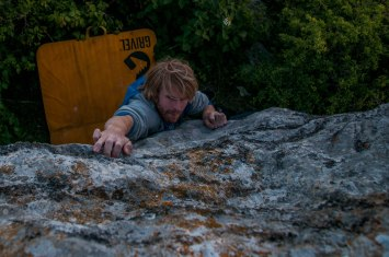 Tom working his way up 'E.T Boulder'